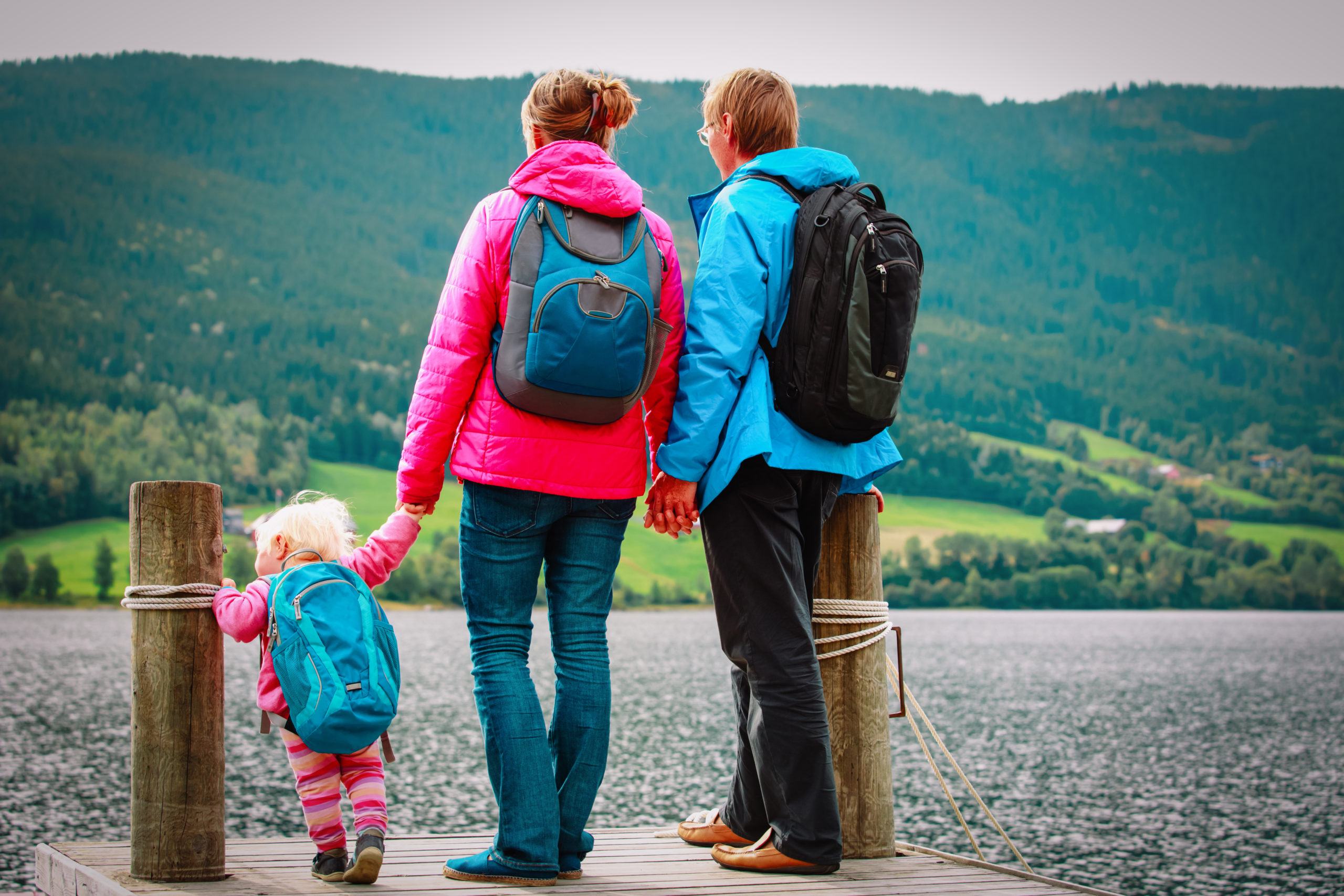 Family With Small Baby Girl Travel Hiking In Nature